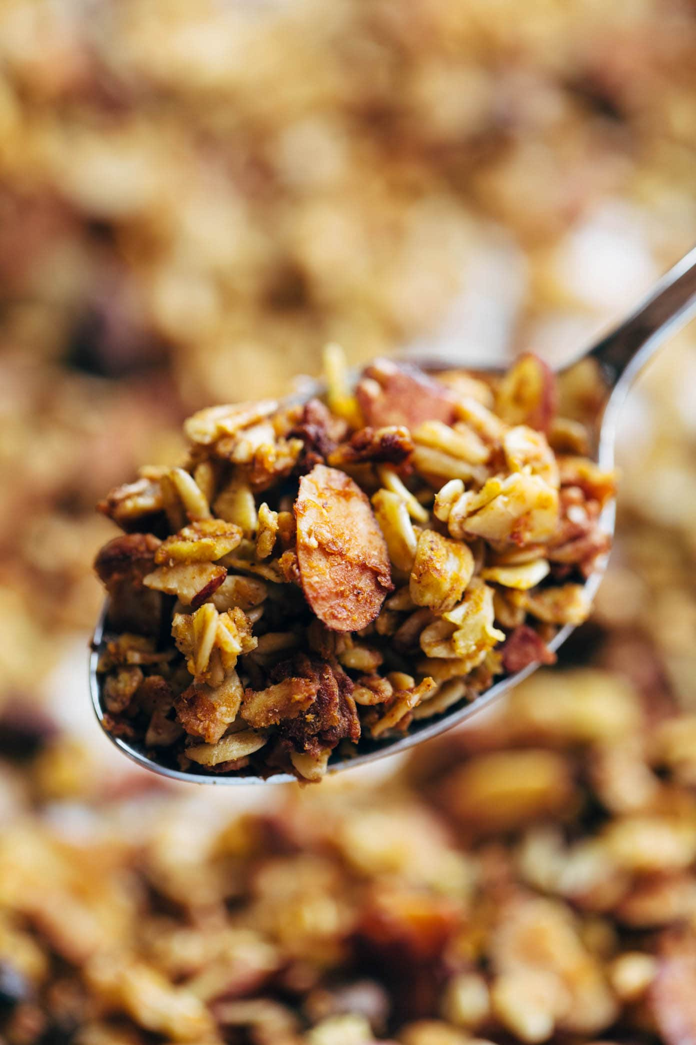 Pumpkin granola on a spoon.