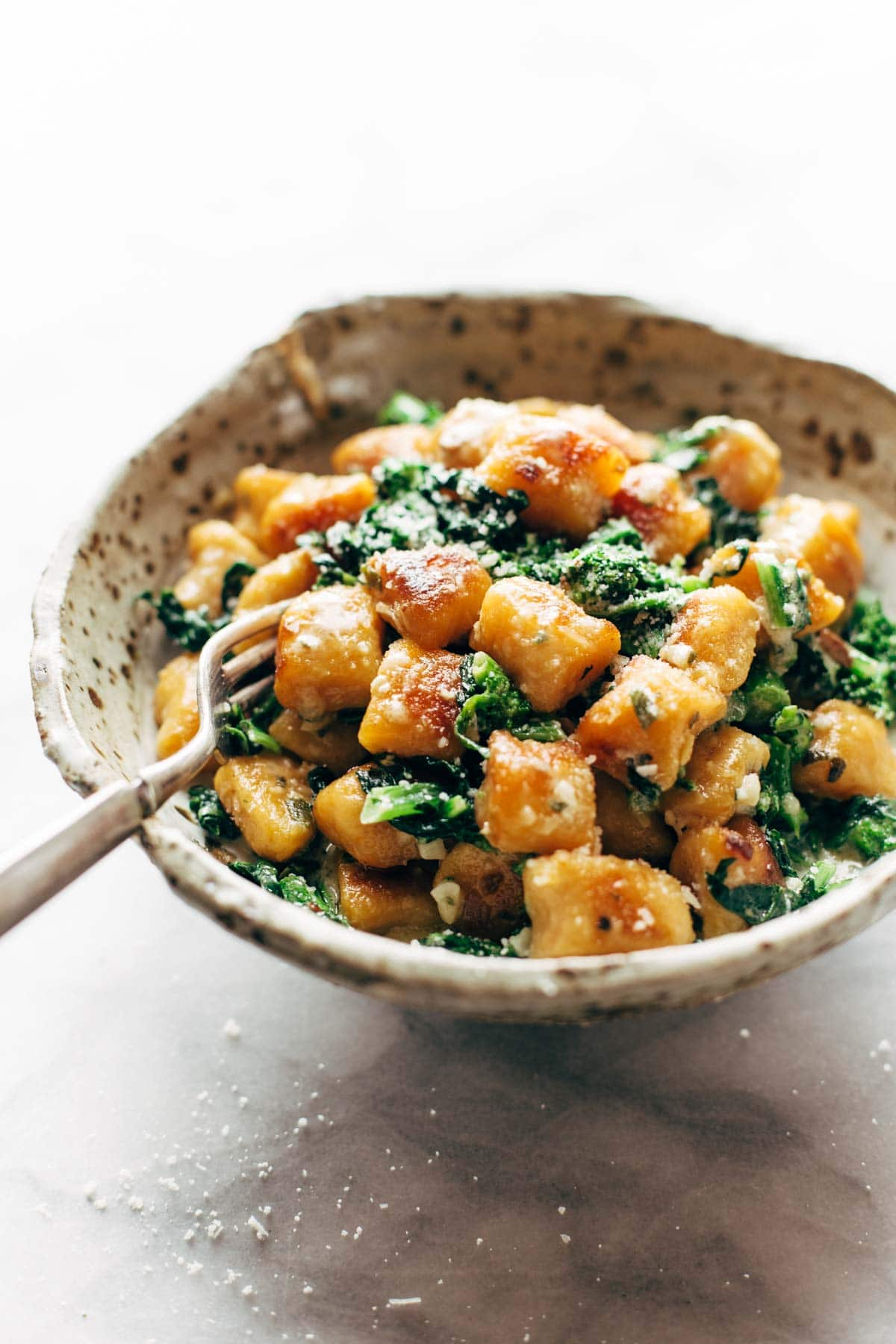 Sweet Potato Gnocchi in a bowl with a fork