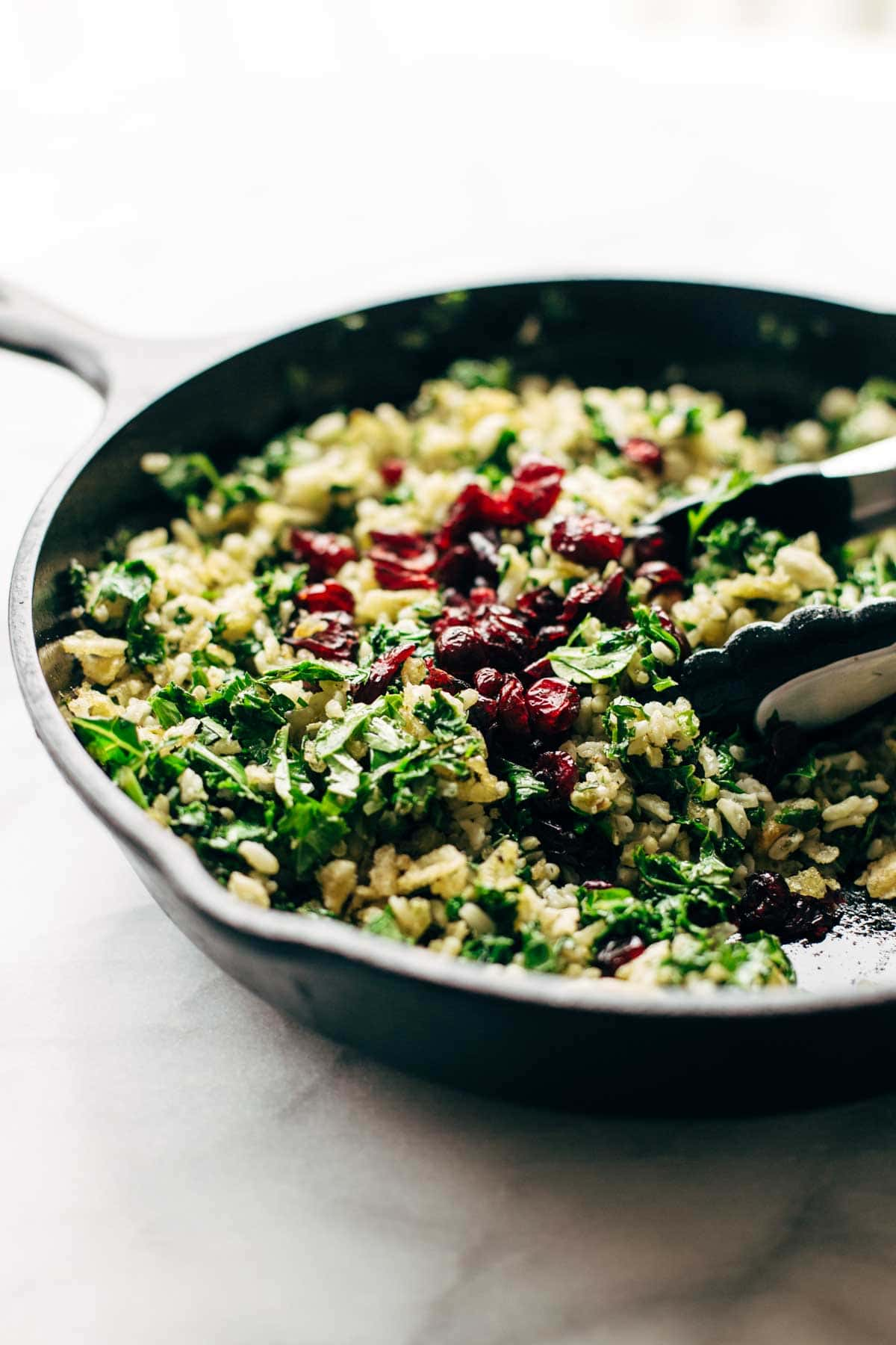 Garlic Kale and Brown Rice Salad with a zippy lemon herb dressing! This side dish recipe is so simple and it compliments almost any main dish!   pinchofyum.com