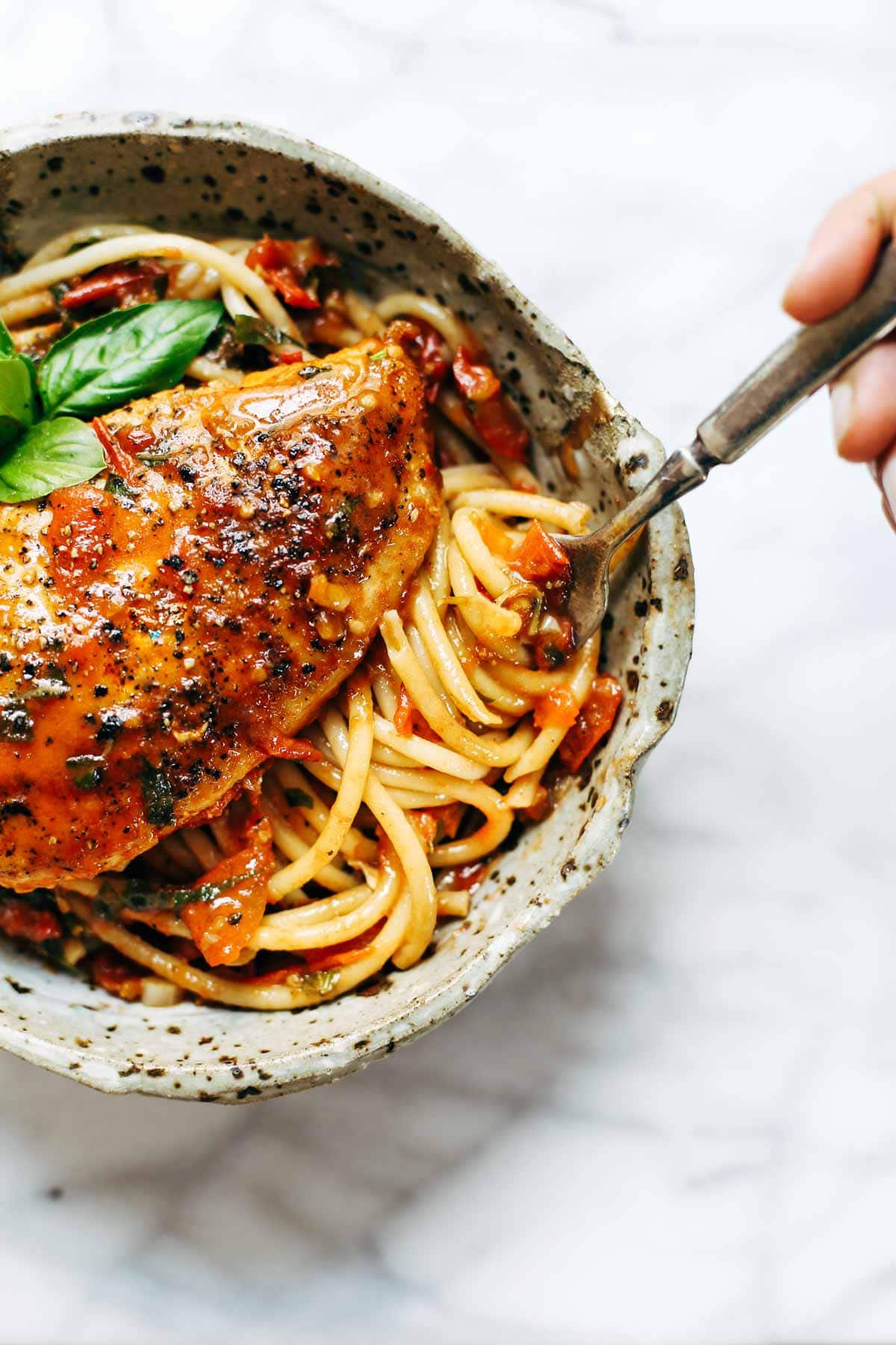Garlic Basil Chicken - you won't believe that this easy real food recipe only requires 7 ingredients like basil, garlic, olive oil, tomatoes, and butter.   pinchofyum.com