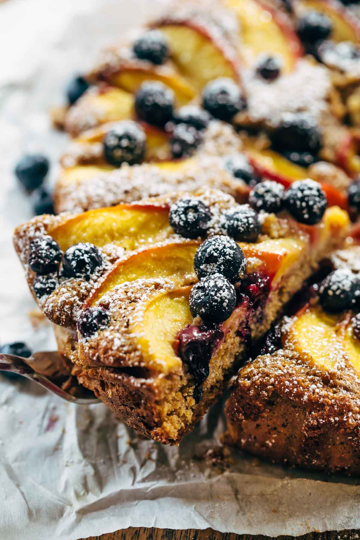 Blueberry Peach Cake recipe uses simple ingredients, whole wheat, no refined sugar, and has a STUNNING presentation. YUM! | pinchofyum.com