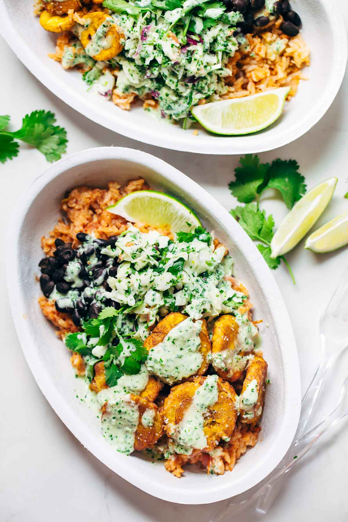 Spicy Brazilian Burrito Bowls recipe featuring seasoned rice and beans, garlic cilantro lime slaw, and crispy fried plantains. So good // almost vegan. | pinchofyum.com