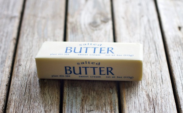 Butter on a wooden surface.