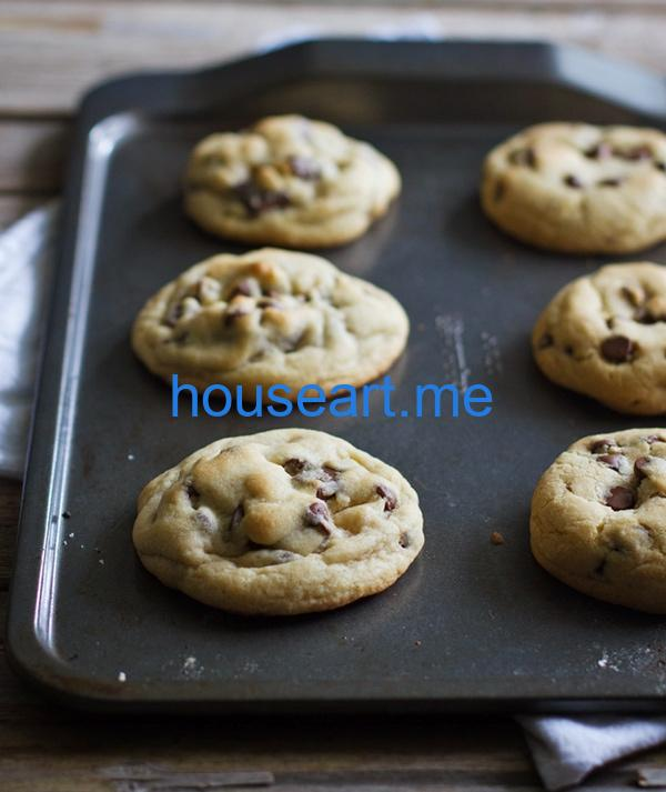 Chocolate chip cookies on a baking pan.