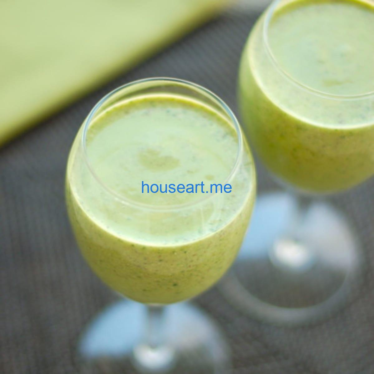Green monster smoothies in glasses.