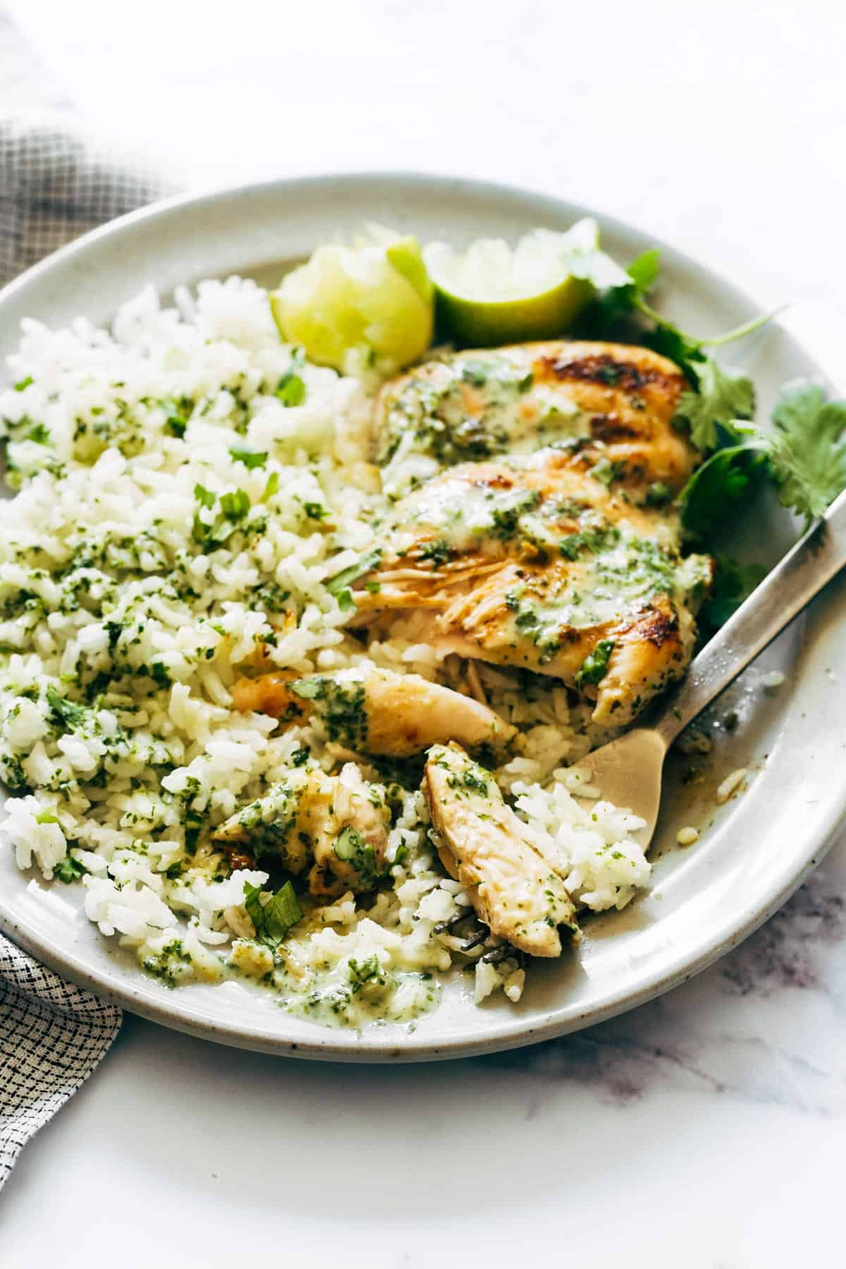 Coconut Lime Grilled Chicken and rice with bite on fork.