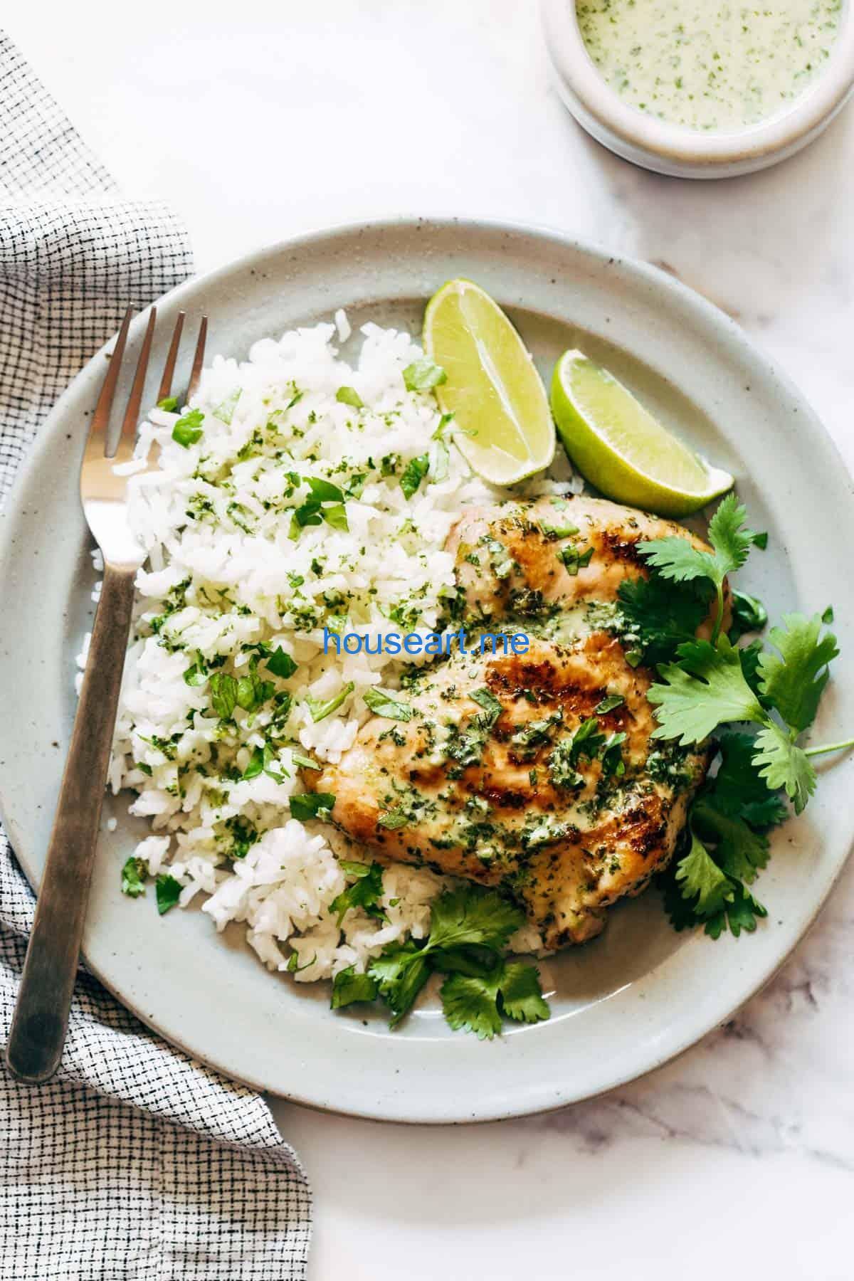 Coconut Lime Grilled chicken with rice on a plate.